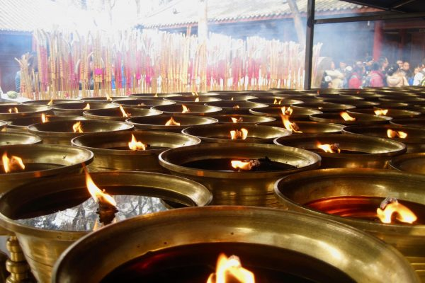 Burning oil candles at a temple in Jinan, China. ©KettiWilhelm2014