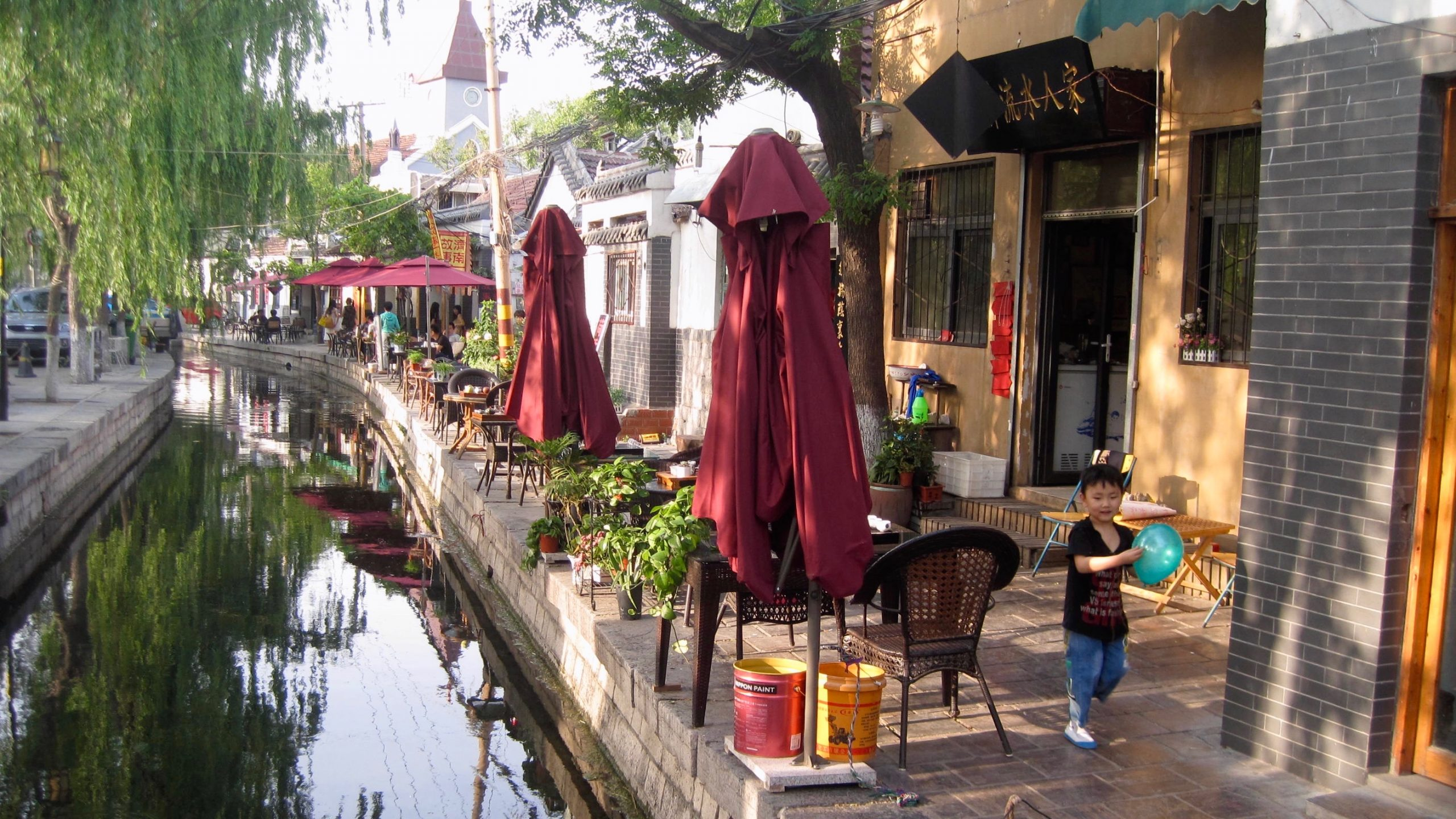 A kid playing by a canal in Jinan, the city where I work as an expat teaching English in China. ©KettiWilhelm2015