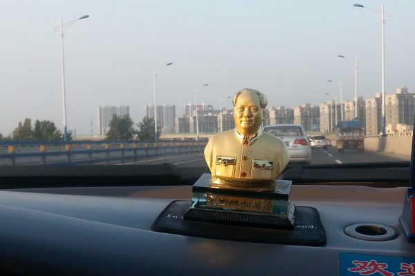 Communist leader Mao Zedong as a decoration on the dashboard of a Chinese taxi.