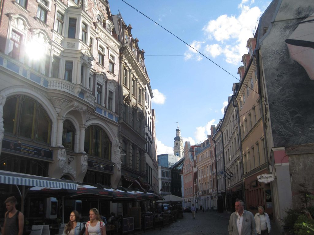 Pedestrians and elegant buildings on a curved street in downtown Riga, Latvia.  ©KettiWilhelm2015