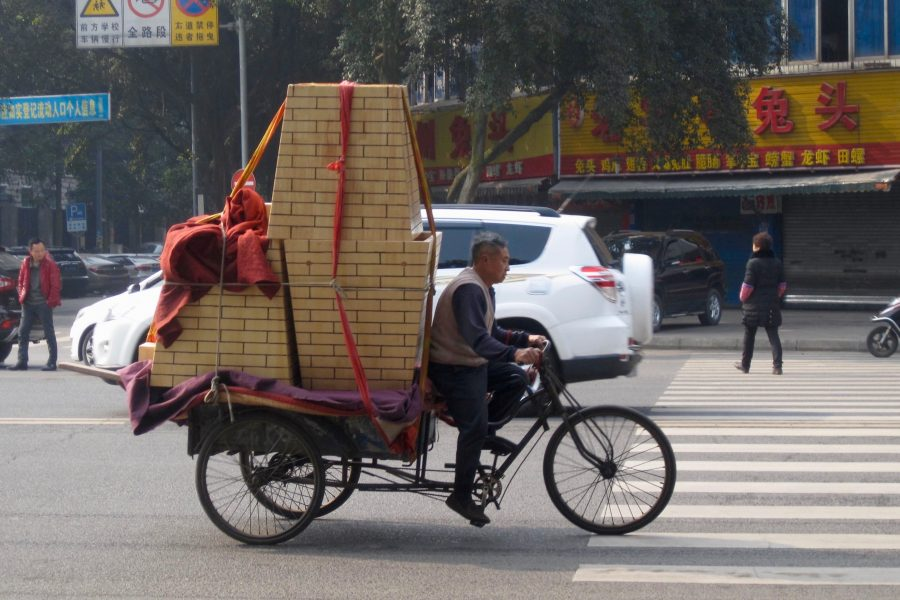 Offline shopping in China – a man delivering good on an overloaded bicycle. ©KettiWilhelm2015