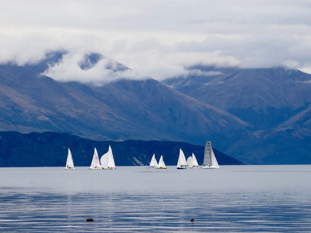 White sailboats and blue mountains on Lake Wanaka, South Island of New Zealand. ©KettiWilhelm2016