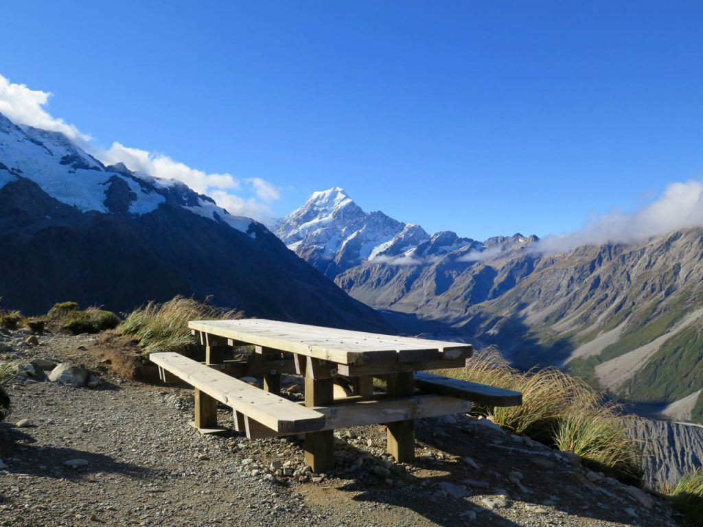 A pic-nic table, sunshine, and New Zealand's Mount Cook in the distance. ©KettiWilhelm2016