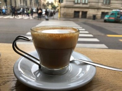 "A caffè macchiato (espresso drink ""marked"" with milk foam) at a bar in Milan. (Breakfast is the easiest Italian meal in this guide.) ©KettiWilhelm2017"