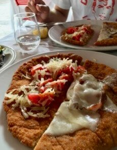 How to try as many menu items as possible in Italy? Split two with a friend, like these two styles of Cotoletta alla Milanese. ©KettiWilhelm2017