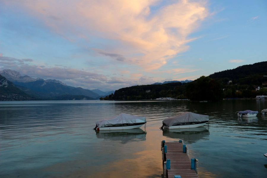 When you visit France, sit on the dock in the town of Annecy and watch a pink and blue sunset like this one, and contemplate why all the flowery, pink French toilet paper has a matching motif. ©KettiWilhelm2019