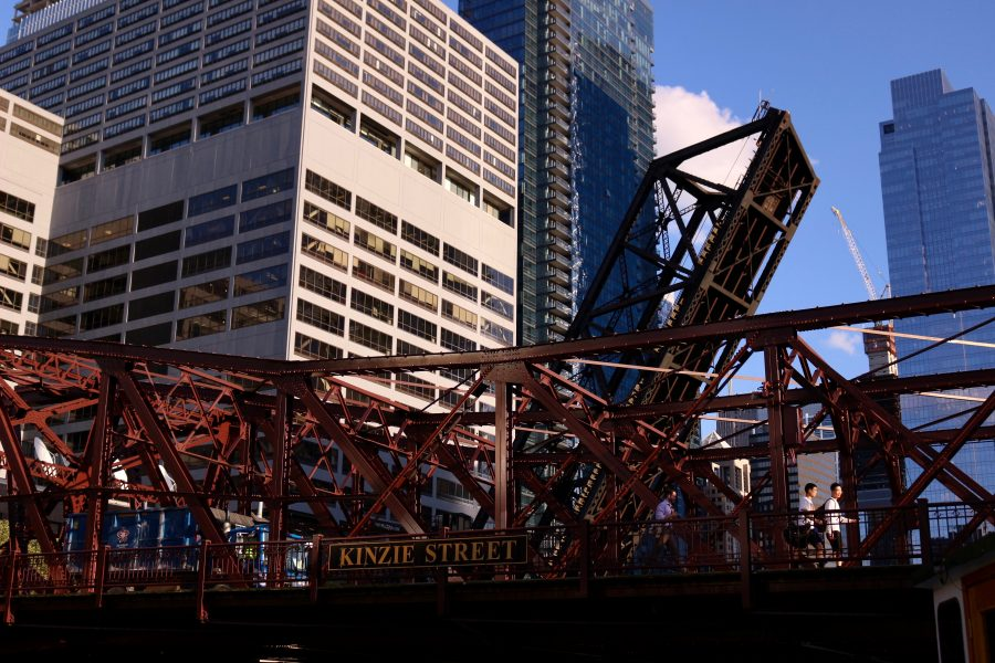 Pedestrians cross Chicago's Kinzie Street bridge in the sunshine. ©KettiWilhelm2019