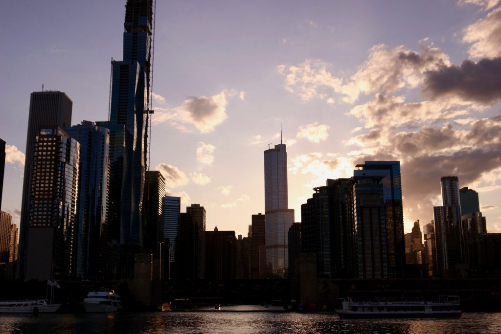 The dark Chicago skyline at sunset seen from Lake Michigan aboard an architecture boat tour. ©KettiWilhelm2019