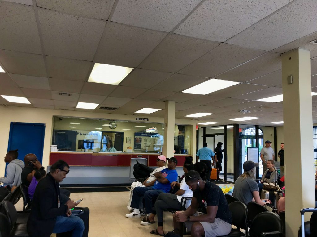 Passengers waiting in the tiny waiting room inside the Detroit Amtrak train station on West Baltimore Avenue. ©KettiWilhelm2019