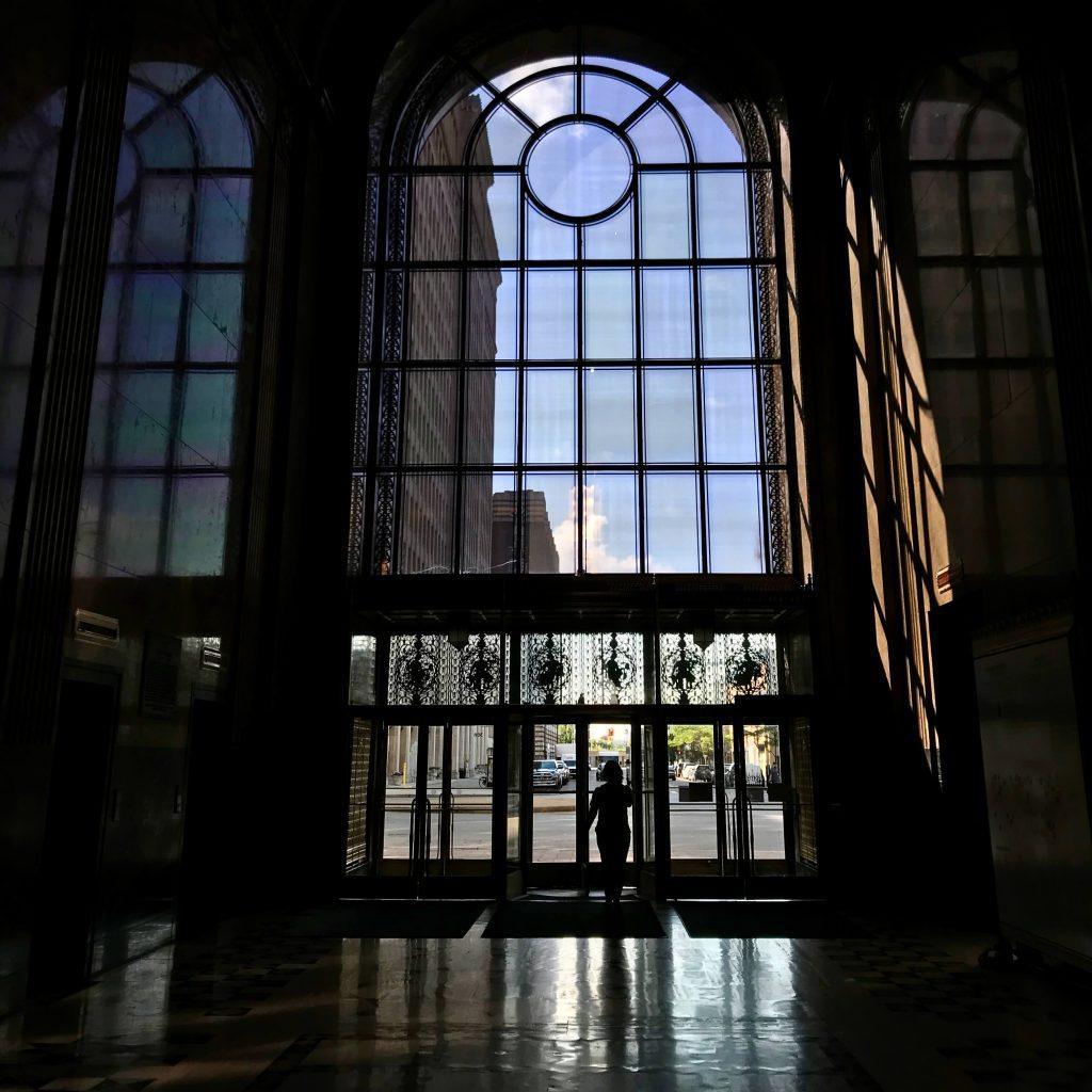 Sunlight on the glass front doors of Detroit's art-deco-style Fischer Building. ©KettiWilhelm2019