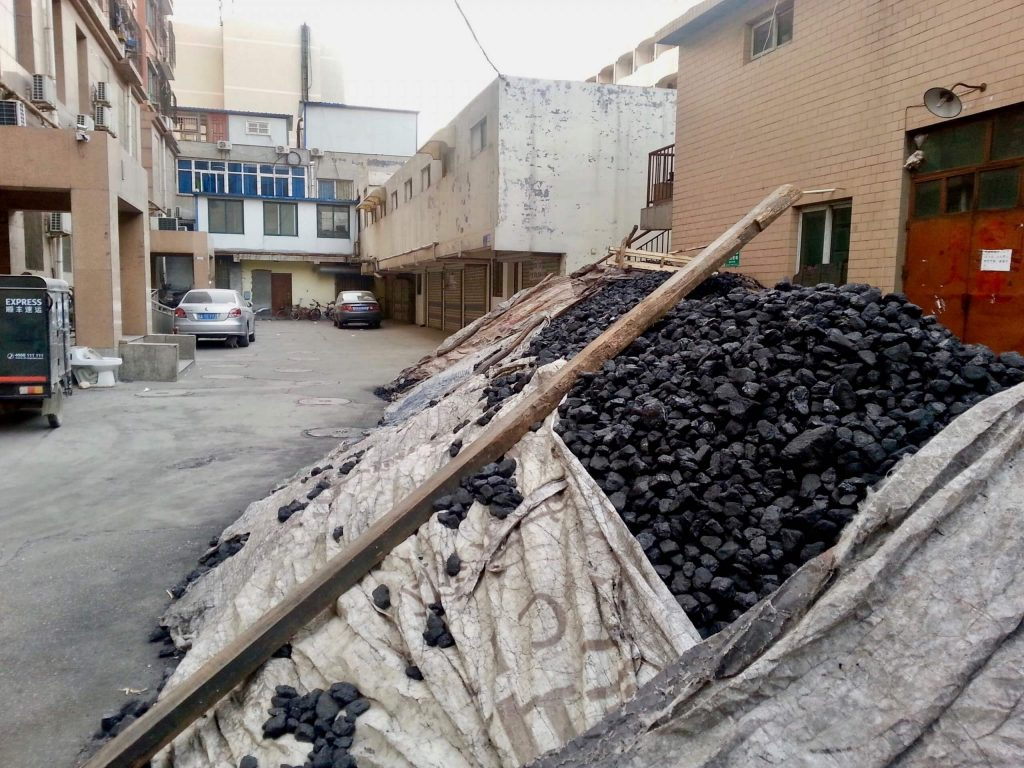 A pile of coal to be burned for heating outside an apartment building in Jinan, China. ©KettiWilhelm2014
