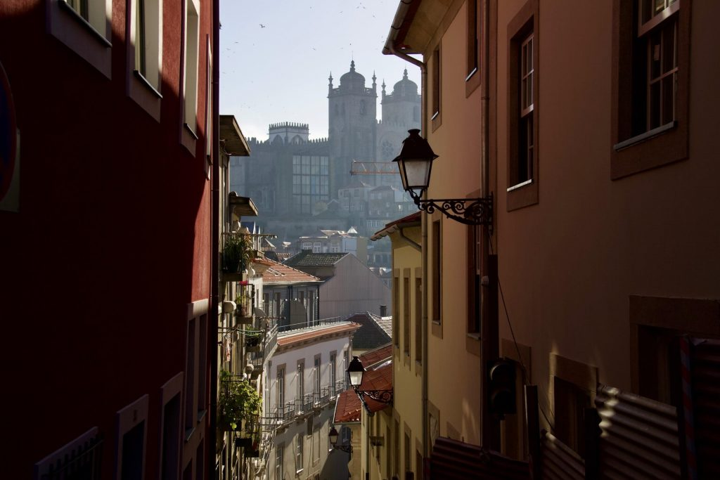 Looking down an alley in Porto, Portugal, toward the Church of Santa Clara in the mist. ©KettiWilhelm2020