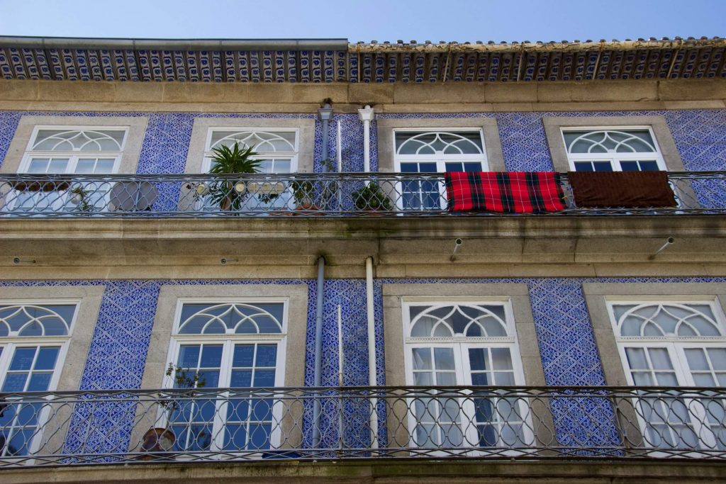 Homes with balconies and blue tiles seen on a two-day Couchsurfing layover in Porto, Portugal. ©KettiWilhelm2020
