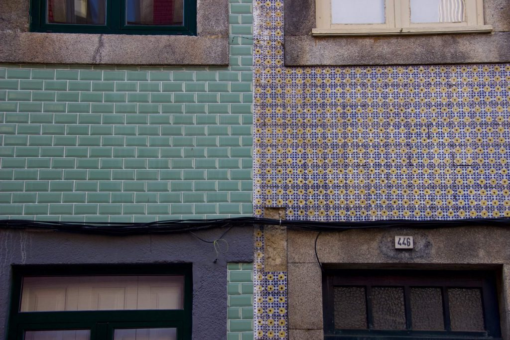 Colorful blue, green, and floral tiled buildings in Porto, Portugal. ©KettiWilhelm2020