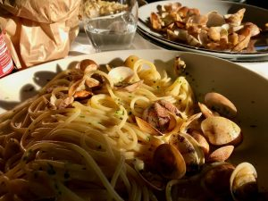 A plate of spaghetti con vongole (spaghetti with fresh clams) in Naples, Italy. ©KettiWilhelm2020