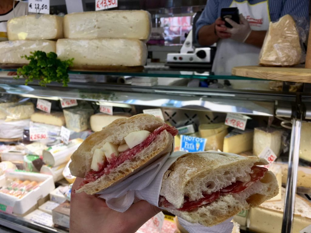 Simple cheese and salami Italian sandwiches in front of my favorite cheese stall at the market in Milan. ©KettiWilhelm2020