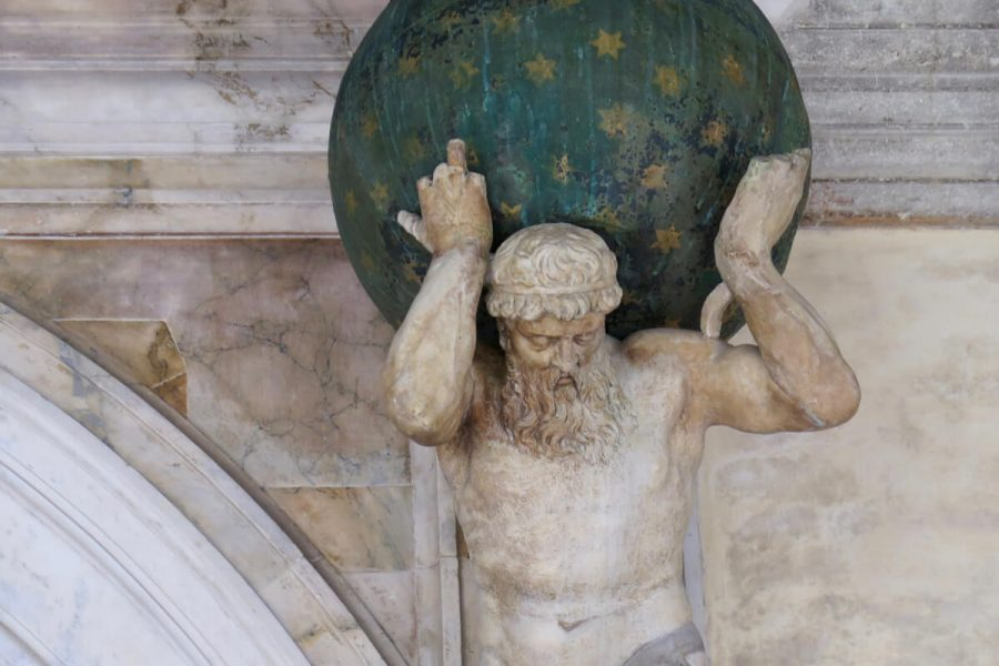 A sculpture in Venice, Italy, of Atlas holding up a a green globe, dotted with gold stars to represent the heavens. ©KettiWilhelm2017