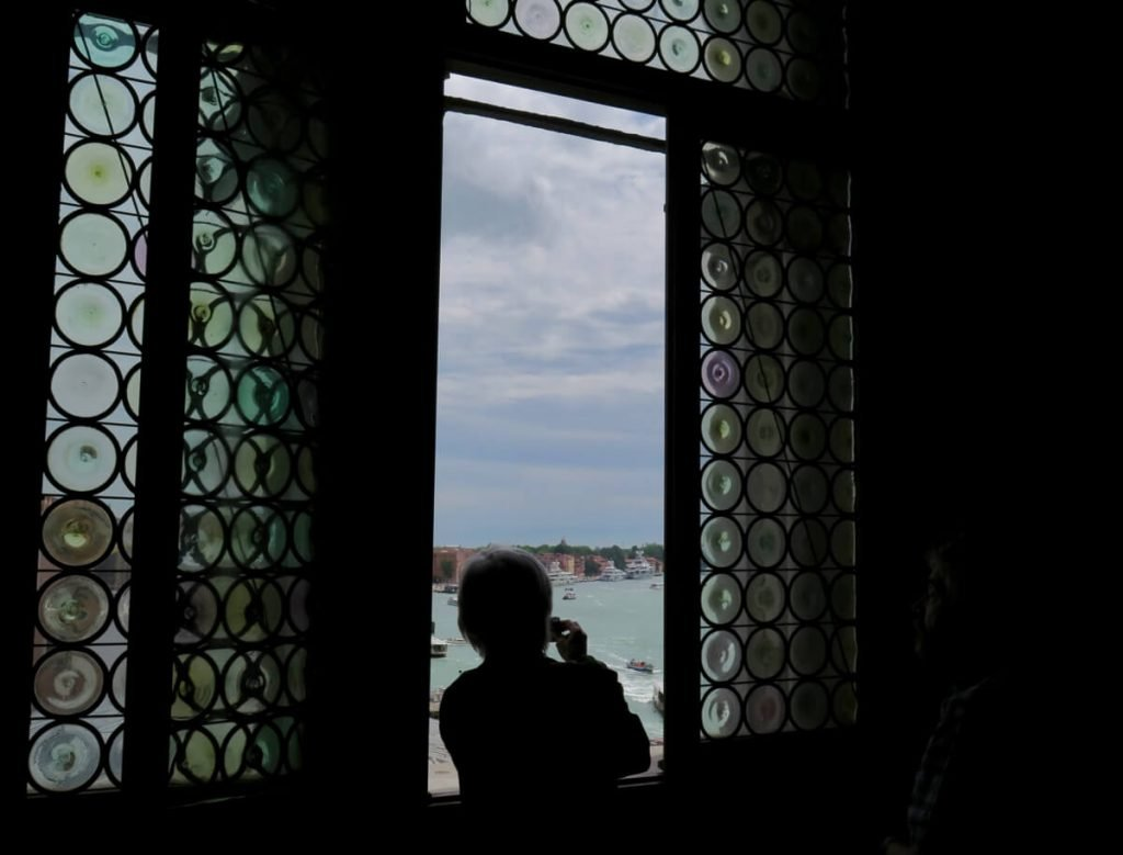 Looking out a stained glass window at the port of Venice, Italy, where you can see both the past and the future of travel. ©KettiWilhelm2017