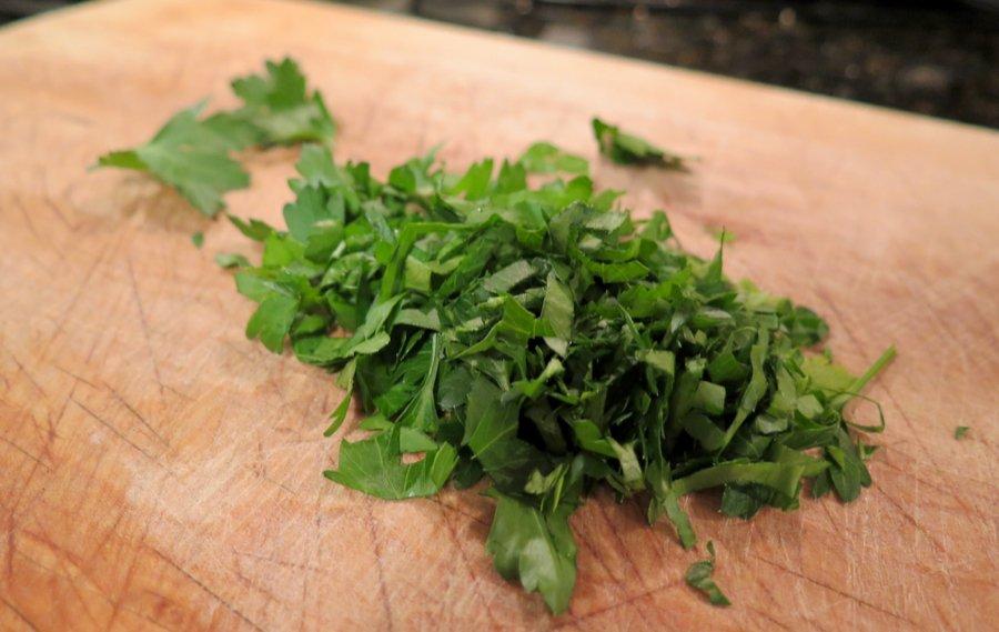 Chopped up Italian parsley on a cutting board. ©KettiWilhelm2020