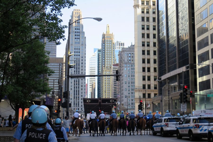 Police lined up on horseback on Chicago's Michigan Avenue, during protests over George Floyd's death. ©KettiWilhelm2020