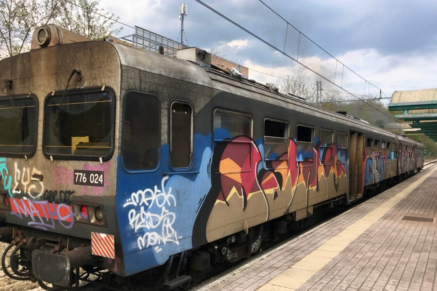 A regional train in Umbria, Italy, covered in colorful graffiti. ©KettiWilhelm2020