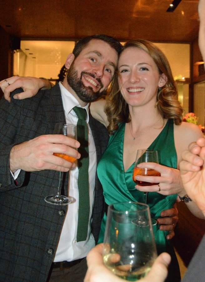 The bride (me) and groom drinking Spritz cocktails at our wedding in Milano.