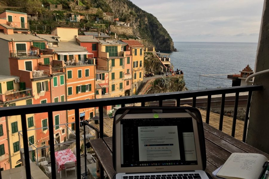 Working on my travel blog on my balcony overlooking the colorful houses of Riomaggiore, Italy. ©KettiWilhelm2020