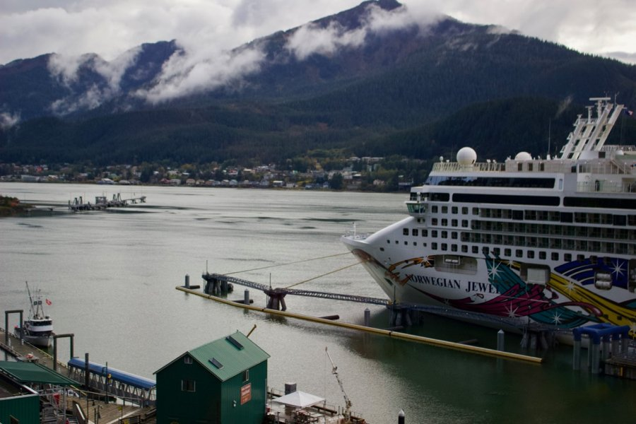 A Norwegian cruise ship in port in Juneau, Alaska. Cruise ships have many sustainability problems, including causing air pollution and water pollution. ©KettiWilhelm2020