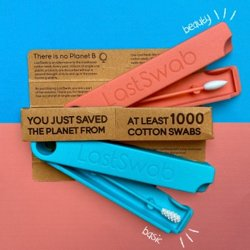 Two LastSwab reusable cotton swabs on a bright blue and coral colored background. (Click to apply a discount code.)
