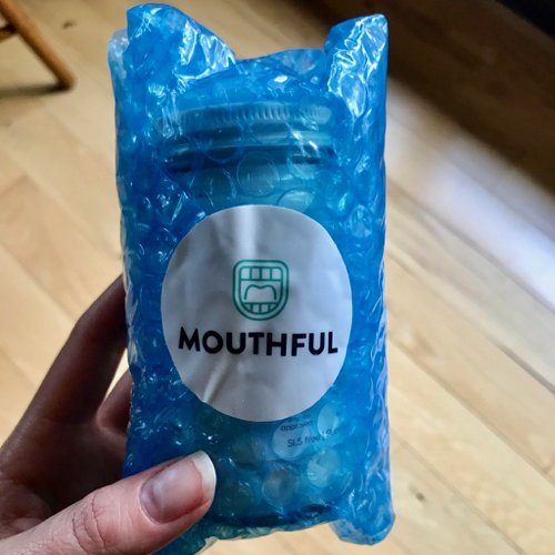 A jar of Mouthful toothpaste tablets (which are compared with Bite toothpaste bits in this review), as they arrived – packaged in non-recyclable blue plastic bubble wrap. ©KettiWilhelm2020