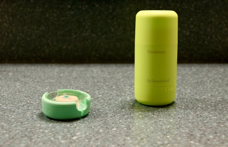 Two plastic-free toiletries from byHumankind (reviewed and tested in this article) sit on the blogger's turquoise-colored bathroom counter. The zero-waste floss container is pale green; the refillable deodorant container is very bright green, making for a wacky color combination with the green-ish countertop. ©KettiWilhelm2020