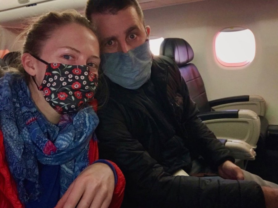 A selfie of the author and her husband, both wearing masks, on the first flight of their trip to the Hawaii. ©KettiWilhelm2020
