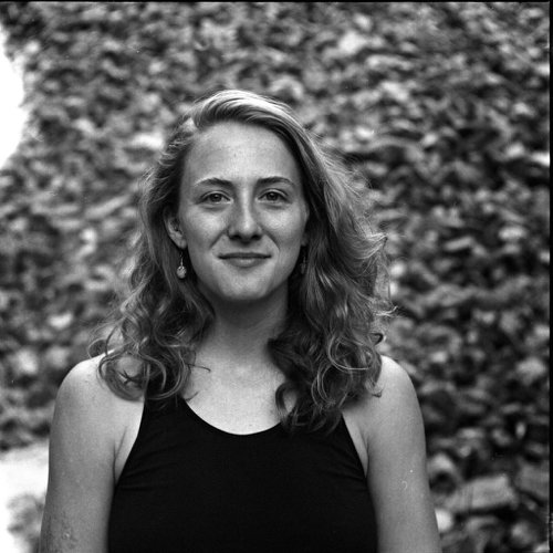 Ketti Wilhelm, author of Tilted Map travel and sustainability blog, a blonde woman shown in a close-up, black and white photo. ©KettiWilhelm2021
