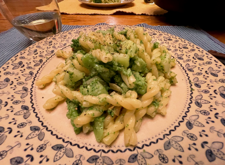 A close-up of a plate of homemade, Italian Pasta with Broccoli from an authentic, family recipe, on a blue and white plate. ©KettiWilhelm2021