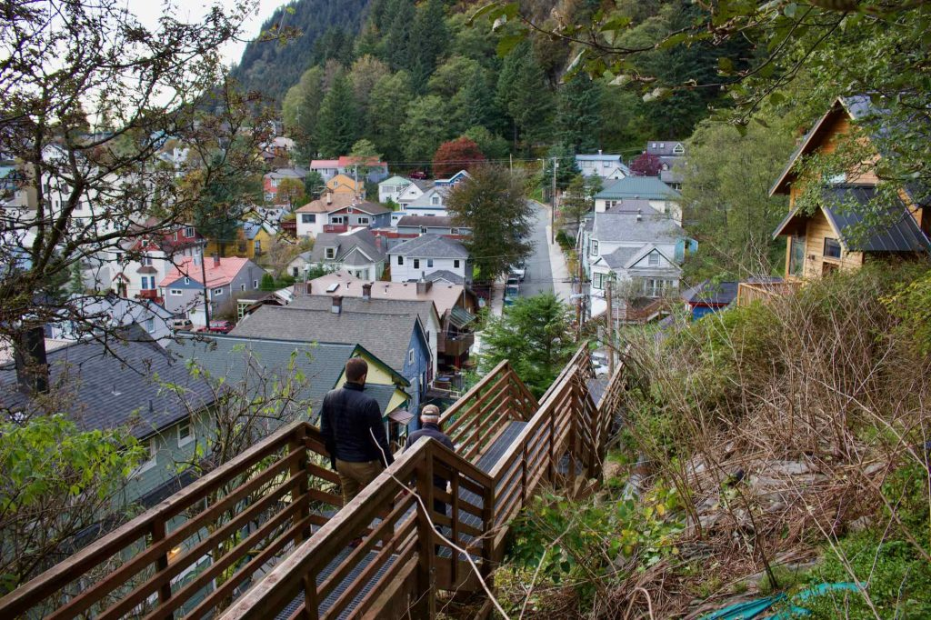 A wooden sidewalk in Juneau, Alaska's, downtown residential area, raised on stilts to accommodate the hilly, rainy, thickly forested surroundings. ©KettiWilhelm2021