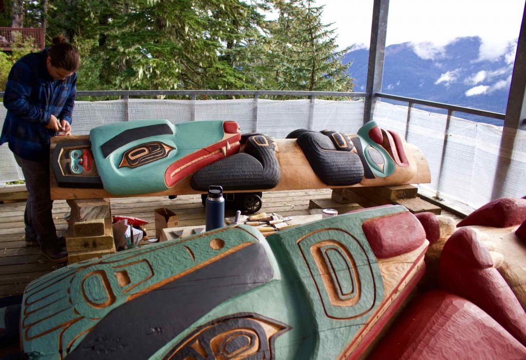 A man carving a totem pole at the top of Mt. Roberts, in Juneau, Alaska. ©KettiWilhelm2021