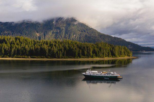 UnCruise's Wilderness Explorer boat sailing in Neka Bay, near Juneau, Alaska.