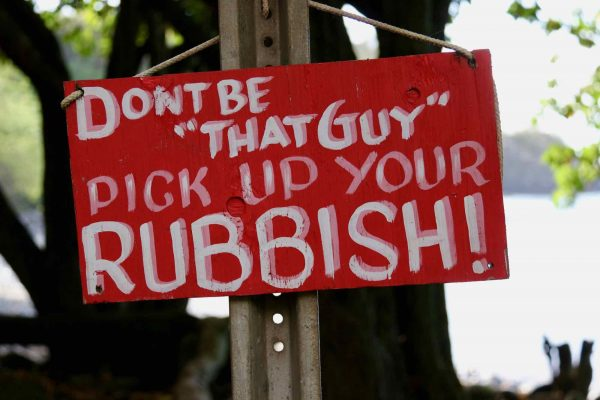 """A red, hand-painted sign in the eco destination of Maui that reads """"Don't be that guy, pick up your rubbish!!"""" Feels appropriate for this review of TerraCycle."""