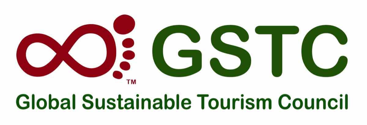 The logo for the Global Sustainable Tourism Council, a certifying body for sustainable travel companies. (A red outline of a footprint, with dark green text.)