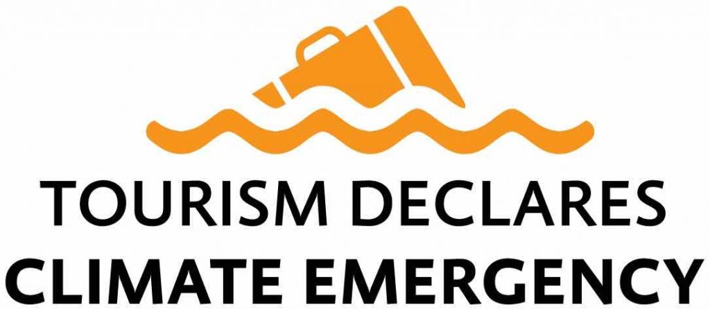 The logo of the sustainable travel organization Tourism Declares A Climate Emergency, an orange suitcase floating in water.